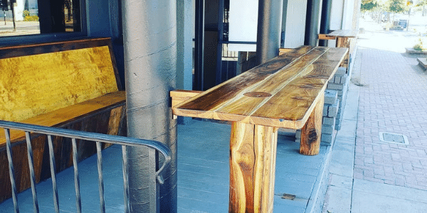 Image of beautiful new solid wood benches and tables outside Craft Roots