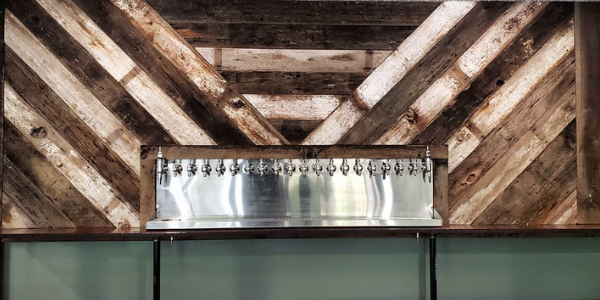 Image of the reclaimed barn wood bar backsplash at Craft Roots